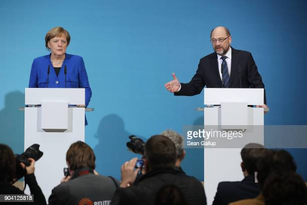 German Chancellor and head of the German Christian Democrats Angela Merkel and leader of the German Social Democrats Martin Schulz along with...