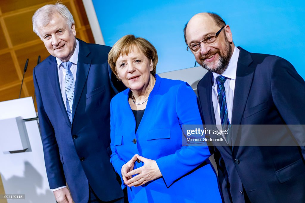 German Chancellor and head of the German Christian Democrats (CDU) Angela Merkel, Bavarian Governor and leader of the Bavarian Christian Democrats (CSU) Horst Seehofer and leader of the German Social Democrats (SPD) Martin Schulz attend a meeting with journalists following all-night preliminary coalition talks on January 12, 2018 in Berlin, Germany.