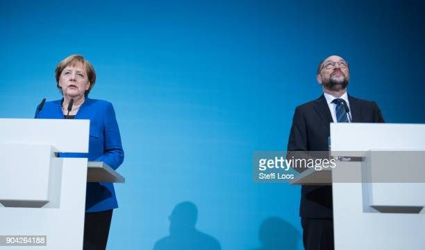 German Chancellor and head of the German Christian Democrats Angela Merkel and leader of the German Social Democrats Martin Schulz give statements...