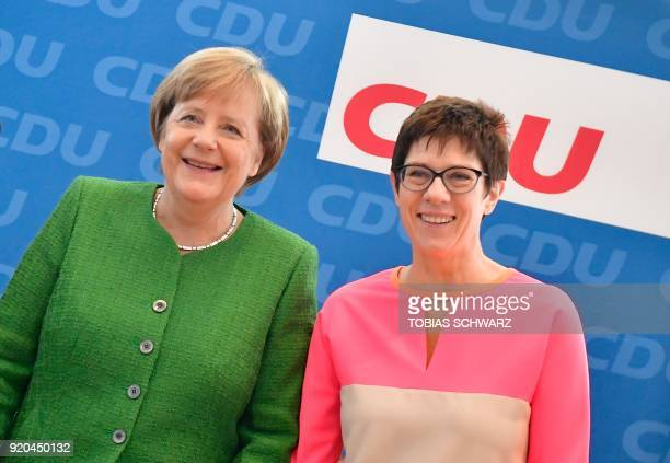 German Chancellor and leader of Germany's conservative Christian Democratic Union Angela Merkel poses with Annegret KrampKarrenbauer State Premier of...