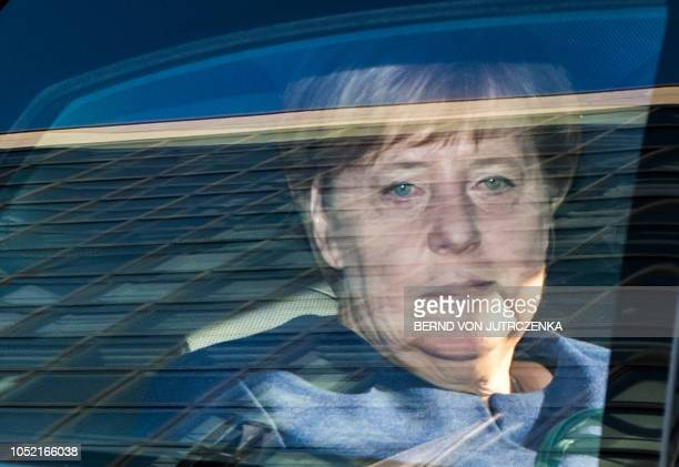 TOPSHOT German Chancellor and leader of the Christian Democratic Union Angela Merkel arrives in her car to attend a leadership meeting of the CDU at...