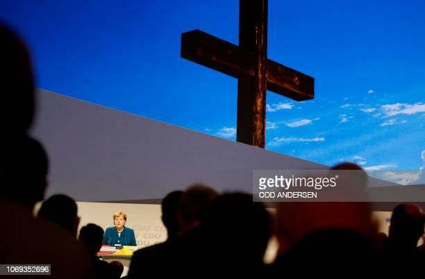 German Chancellor and leader of the Christian Democratic Union Angela Merkel and delegates commemorate members of their CDU party who died during the...