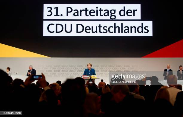 German Chancellor and leader of the Christian Democratic Union Angela Merkel welcomes delegates at the beginning of a party congress of Germany's...