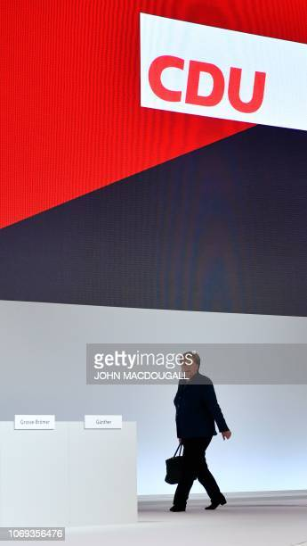 German Chancellor and leader of the Christian Democratic Union Angela Merkel arrives on the podium at the start of a party congress of Germany's...