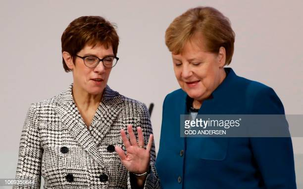 German Chancellor and leader of the Christian Democratic Union Angela Merkel talks with the Secretary General of the Christian Democratic Union...