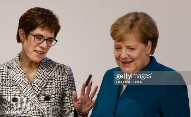 TOPSHOT German Chancellor and leader of the Christian Democratic Union Angela Merkel talks with the Secretary General of the Christian Democratic...