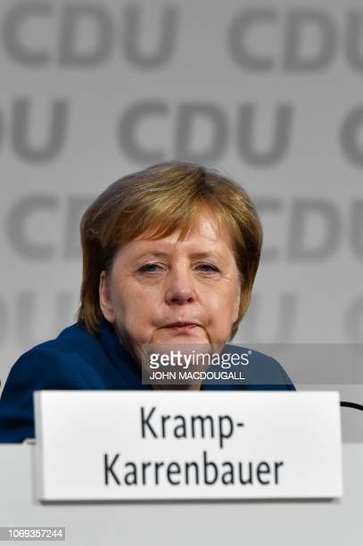 German Chancellor and leader of the Christian Democratic Union Angela Merkel sits on stage at the start of a party congress of Germany's conservative...