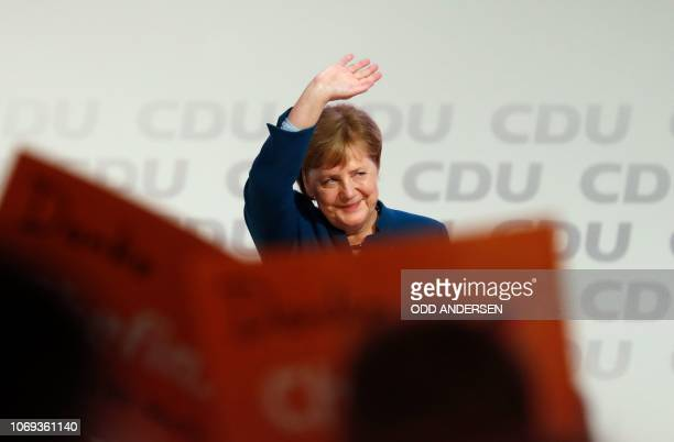 German Chancellor and leader of the Christian Democratic Union Angela Merkel waves after delivering her speech at a party congress of Germany's...