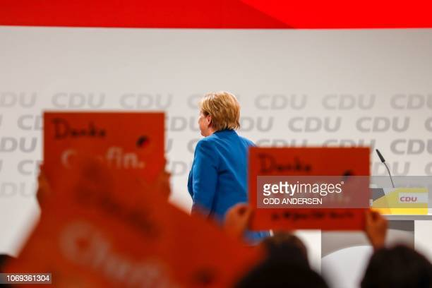 German Chancellor and leader of the Christian Democratic Union Angela Merkel leaves the podium after delivering her speech at a party congress of...