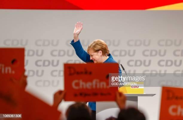 TOPSHOT German Chancellor and leader of the Christian Democratic Union Angela Merkel waves after delivering her speech at a party congress of...