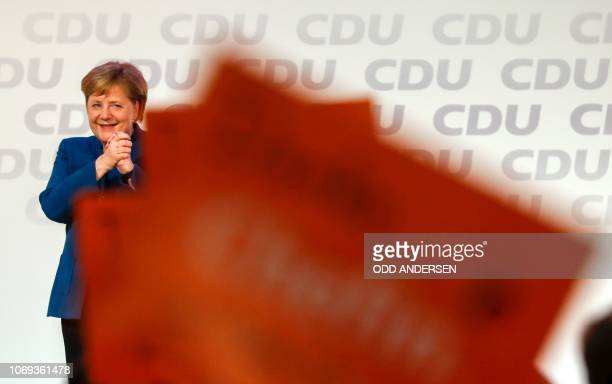 German Chancellor and leader of the Christian Democratic Union Angela Merkel cheers after delivering her speech at a party congress of Germany's...