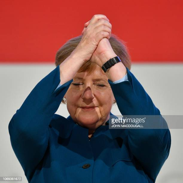 TOPSHOT German Chancellor and leader of the Christian Democratic Union Angela Merkel cheers after delivering her speech at a party congress of...