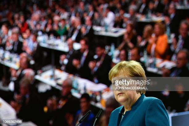 German Chancellor and leader of the Christian Democratic Union Angela Merkel sdelivers her speech at a party congress of Germany's conservative...