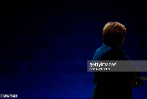 German Chancellor and leader of the Christian Democratic Union Angela Merkel is seen on stage as she attends a party congress of Germany's...
