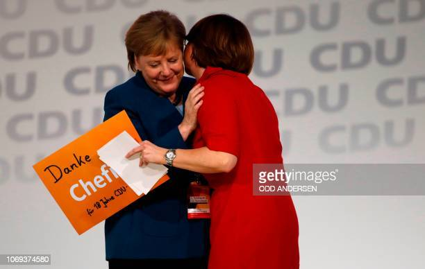German Chancellor and leader of the Christian Democratic Union Angela Merkel is acknowledged by delegate Annette WidmannMauz leader of the CDU's...