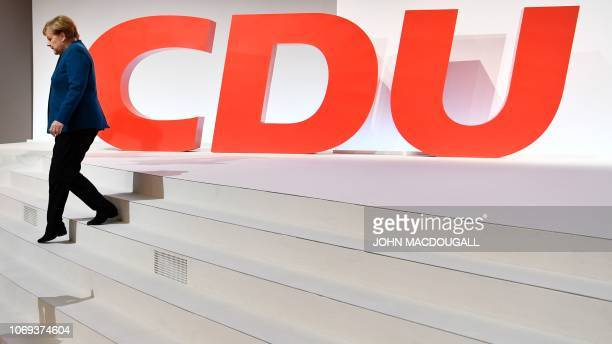 German Chancellor and leader of the Christian Democratic Union Angela Merkel leaves the stage in front of a huge CDU logo after her speech at a party...