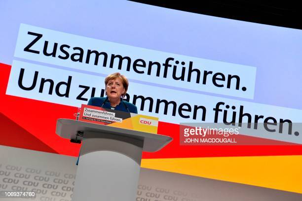 German Chancellor and leader of the Christian Democratic Union Angela Merkel gives a speech during a party congress of Germany's conservative...
