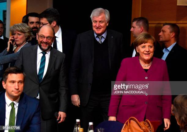 German Chancellor and leader of the Christian Democratic Union Angela Merkel the leader of the Social Democratic Party Martin Schulz and the chairman...