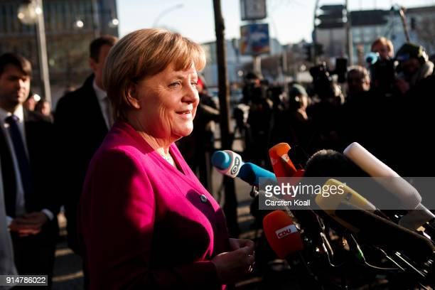 German Chancellor and leader of the Christian Democratic Union Angela Merkel speak to the media about the coalition negotiations at CDU headquarter...
