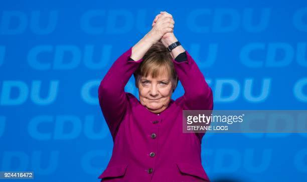 German Chancellor and leader of the Christian Democratic Union Angela Merkel cheers after delivering her speech during the party's congress on...