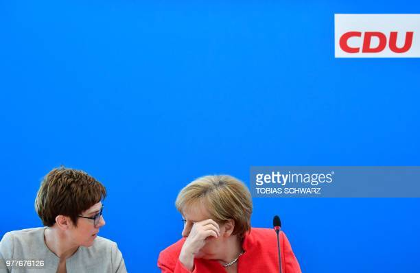 German Chancellor and leader of the Christian Democratic Union Angela Merkel confers with the CDU Secretary General Annegret KrampKarrenbauer prior...