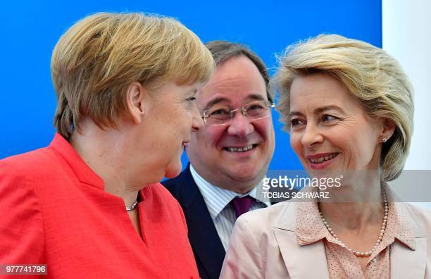 German Chancellor and leader of the Christian Democratic Union Angela Merkel talks German Defence Minister and CDU Deputy Chairwoman Ursula von der...