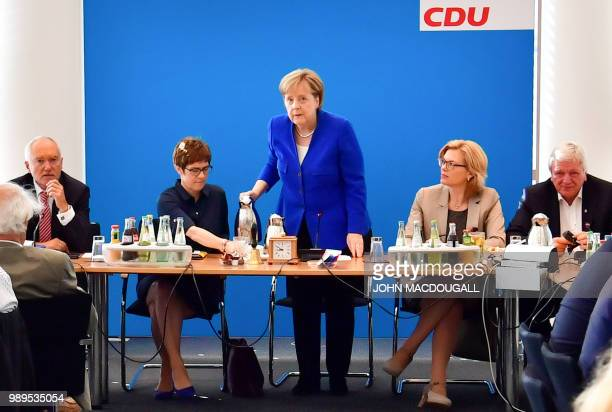German Chancellor and leader of the Christian Democratic Union Angela Merkel serves coffee to the Secretary General of the Christian Democratic Union...