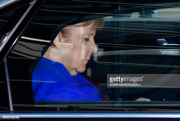 German Chancellor and leader of the Christian Democratic Union Angela Merkel leaves in her car after a party leadership meeting at the CDU...