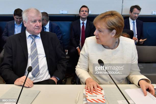 German Chancellor and leader of the Christian Democratic Union Angela Merkel and German Interior Minister and leader of the Bavarian Christian Social...
