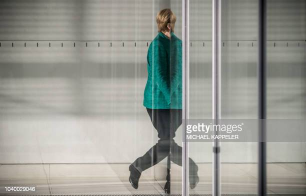 German Chancellor and leader of the Christian Democratic Union party, Angela Merkel leaves the parliamentary compound of the Bundestag in Berlin on...
