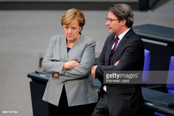 German Chancellor and leader of the Christian Democratic Union party Angela Merkel talks with SecretaryGeneral of the Bavarian Christian Social Union...