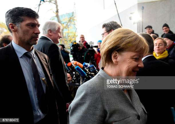 German Chancellor and leader of the Christian Democratic Union party Angela Merkel passes by the chairman of the Bavarian Christian Social Union...