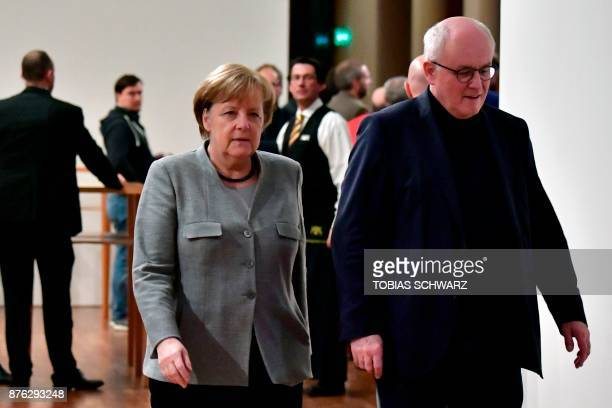 German Chancellor and leader of the Christian Democratic Union party Angela Merkel walks with parliamentary group leader of the conservative CDU/CSU...