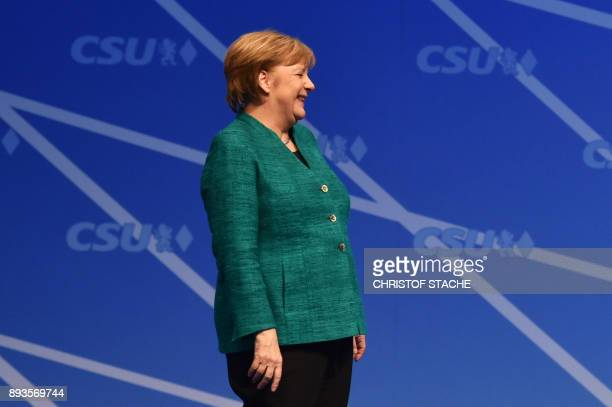 German Chancellor and leader of the Christian Democratic Union party Angela Merkel laughs as she attends the congress of the CSU party the Bavarian...