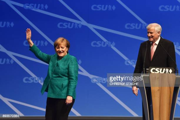 German Chancellor and leader of the Christian Democratic Union party Angela Merkel waves after she delivers her speech while Chairman of the Bavarian...