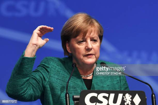 German Chancellor and leader of the Christian Democratic Union party Angela Merkel delivers her speech on December 15 2017 in Nuremberg southern...