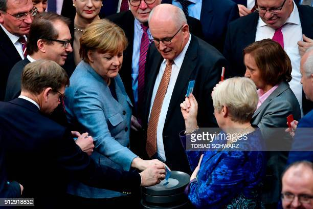 German Chancellor and leader of the Christian Democratic Union party Angela Merkel casts her vote at the German lower house of Parliament Bundestag...