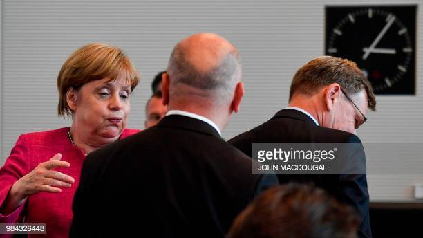 German Chancellor and leader of the Christian Democratic Union party Angela Merkel reacts prior to a meeting of the CDU/CSU parliamentary group in...