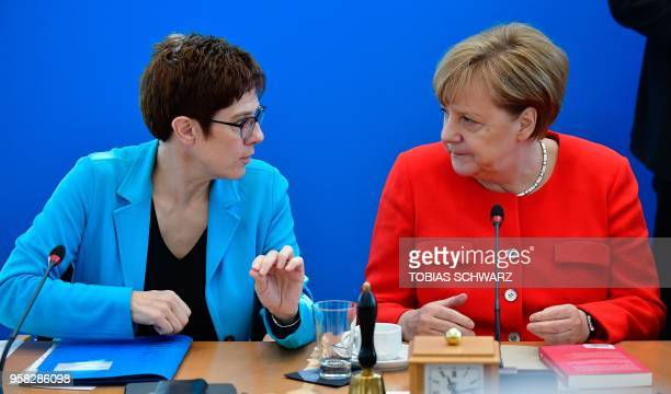 German Chancellor and leader of the Christian Democrats Party Angela Merkel talks with CDU secretary general Annegret KrampKarrenbauer at the...