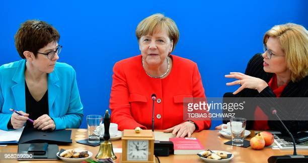 German Chancellor and leader of the Christian Democrats Party Angela Merkel sits between CDU secretary general Annegret KrampKarrenbauer and CDU...