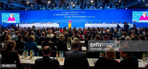 German Chancellor and leader of the conservative Christian Democratic Union party Angela Merkel welcomes delegates for the CDU's party congress on...