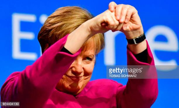 German Chancellor and leader of the conservative Christian Democratic Union party Angela Merkel thanks delegates after giving a speech during the...