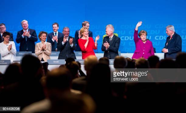 German Chancellor and leader of the conservative Christian Democratic Union party Angela Merkel is applauded by party colleagues Annegret...