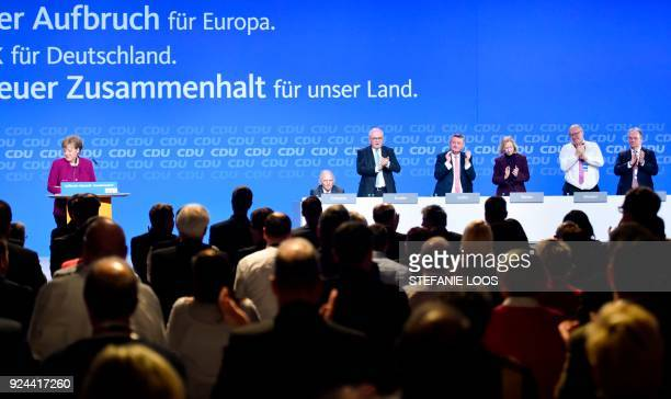 German Chancellor and leader of the conservative Christian Democratic Union party Angela Merkel is applauded by party colleagues Parliament speaker...