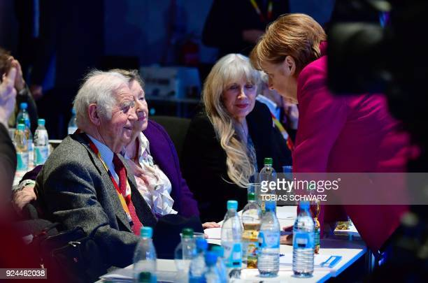 German Chancellor and leader of the conservative Christian Democratic Union party Angela Merkel talks with Saxony's former State Premier Kurt...