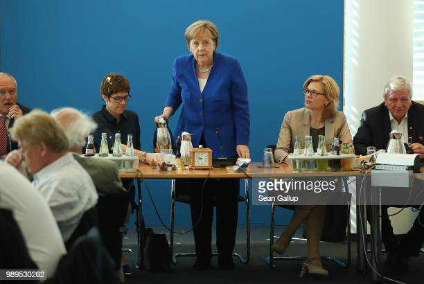 German Chancellor and leader of the German Chistian Democrats Angela Merkel pours coffee as she for an early morning meeting of the CDU governing...