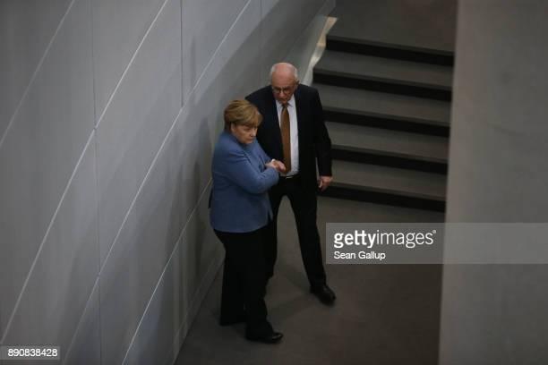 German Chancellor and leader of the German Christian Democarts Angela Merkel speaks with CDU Bundestag faction head Volker Kauder at the Bundestag...