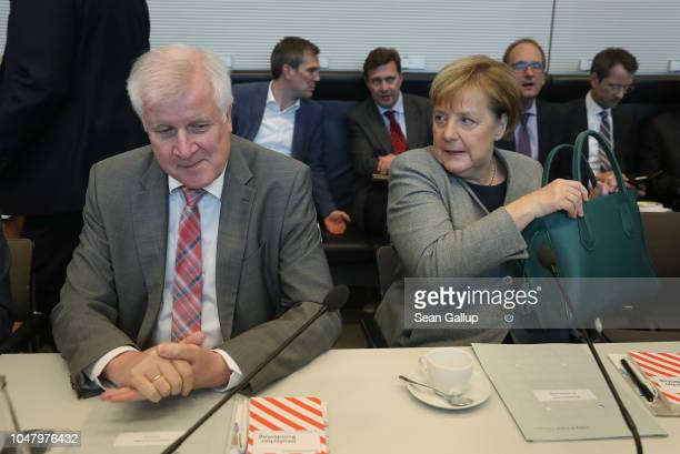 German Chancellor and leader of the German Christian Democratic Union Angela Merkel and Interior Minister and leader of the Bavarian Christian Social...