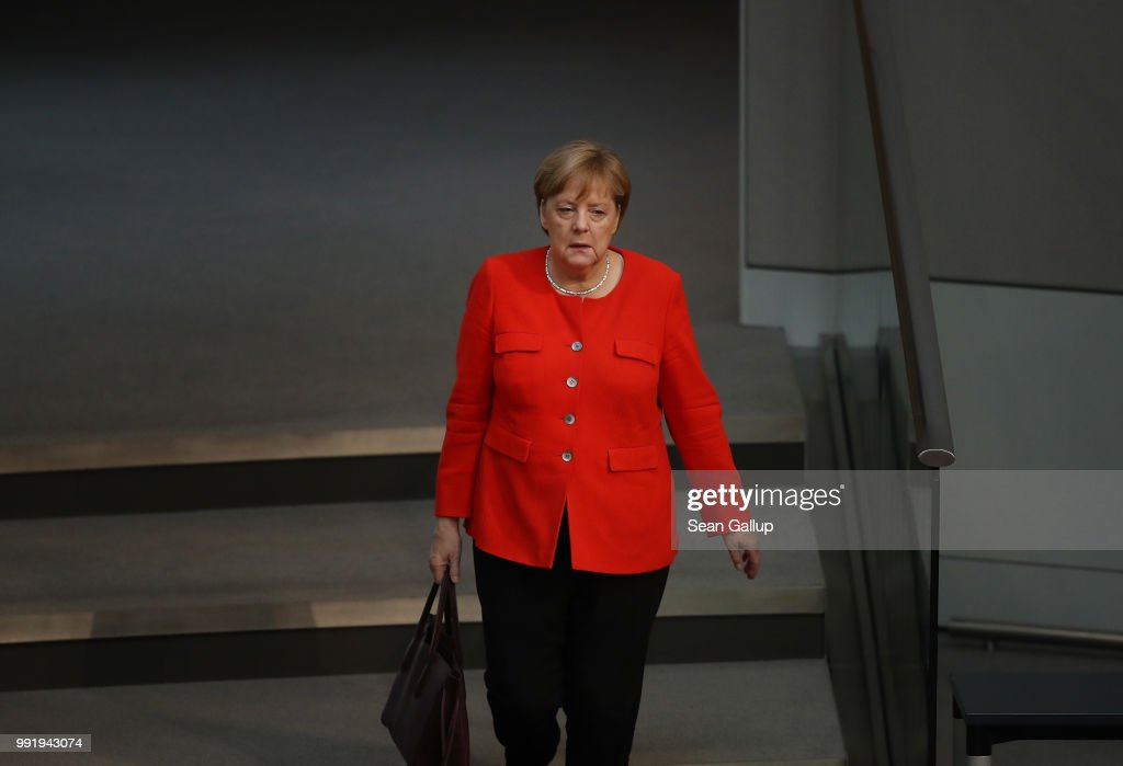 German Chancellor and leader of the German Christian Democratic Union (CDU) Angela Merkel arrives at the last session of the Bundestag before the sumer break on July 5, 2018 in Berlin, Germany. Merkel and Interior Minister and leader of the CDU sister party, the Bavarian Social Union (CSU), Horst Seehofer, recently reached a hard-wrung compromise over migration policy, though uncertainty remains over how the compromise will be implemented.