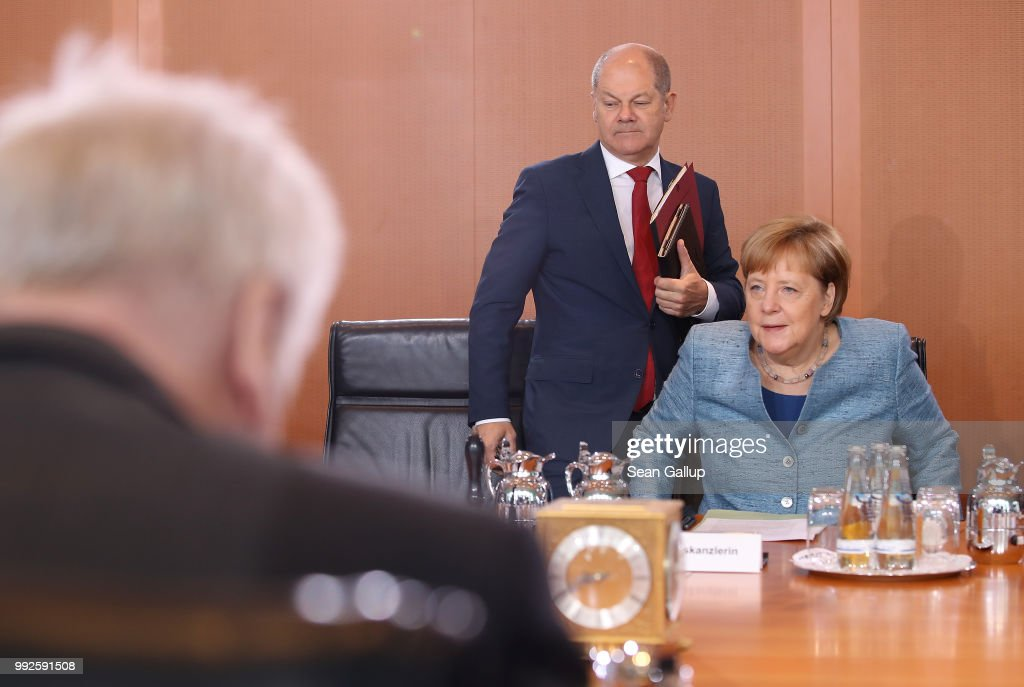 German Chancellor and leader of the German Christian Democratic Union (CDU) Angela Merkel, Vice-Chancellor, Finance Minister and leading member of the German Social Democrats (SPD) Olaf Scholz (C) and Interior Minister and leader of the Bavarian Social Union (CSU) Horst Seehofer attend the weekly German government cabinet meeting on July 6, 2018 in Berlin, Germany. Today's cabinet meeting is the first since government coalition partners reached a hard-wrung compromise over migration policy.